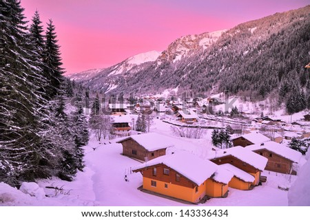 Cityscape of the town of Chatel in the Portes du Soleil in France on a pink morning. HDR - stock photo