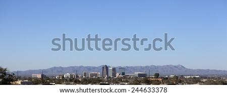 Cityscape of Tucson downtown against mountain range, Arizona; Copy space - stock photo