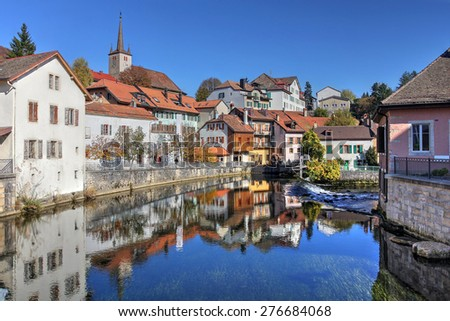 Cityscape of Vallorbe in the Jura Region of Switzerland along the river Orbe. - stock photo