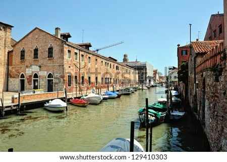Cityscape of Venice. Canal and houses around.