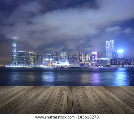Cityscape of Victoria harbor in the night in Hong Kong, Asia. - stock photo