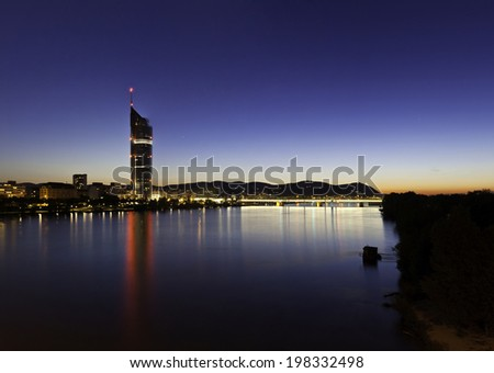 Cityscape of Vienna with the so called Millennium Tower at the Danube River in the summer at dusk with the very last sunshine. - stock photo