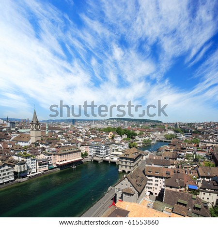 Cityscape of Zurich, Switzerland.  Taken from a church tower overlooking the Limmat River. - stock photo