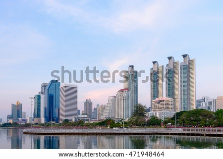 Cityscape, office buildings and apartments in Thailand at dusk. View from public park.