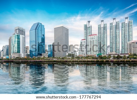 Cityscape on blue sky in Bangkok metropolis - stock photo