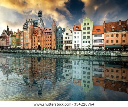 Cityscape on the Vistula River in historic city of Gdansk at sunset  in Poland - stock photo