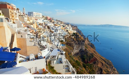 Cityscape panorama of Fira town, Santorini in the late afternoon