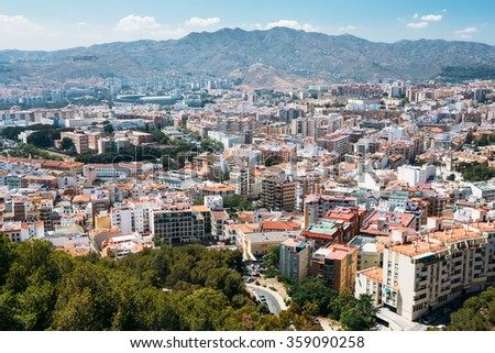 Cityscape panoramic aerial view of Malaga, Spain. Panorama of residential houses. - stock photo