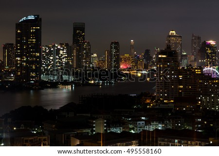 Cityscape photography along the river Charoenkrung Road area in Bangkok, Thailand at the night.
