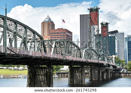 Cityscape shot taken in Portland, Oregon over looking the Hawthorn bridge on a nice summer day. - stock photo