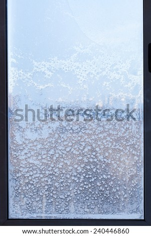 cityscape through the snow-covered window in cold winter day - stock photo