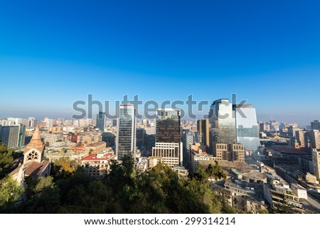 Cityscape view of Santiago, Chile with a church visible in the bottom left