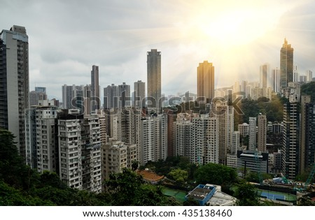 Cityscape view with condos and office buildings and sun beam