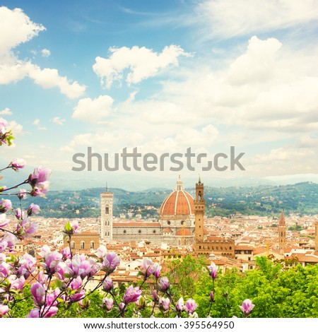 cityscape with church Santa Maria del Fiore at spring day with blooming magnolia, Florence, Italy - stock photo