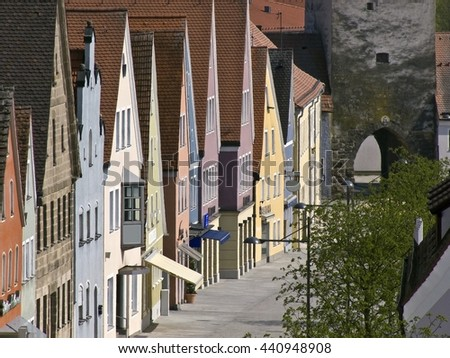 Cityscape with medieval facades in bright colors - stock photo
