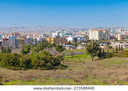 Cityscape with modern buildings under blue sky. Izmir city, Turkey - stock photo