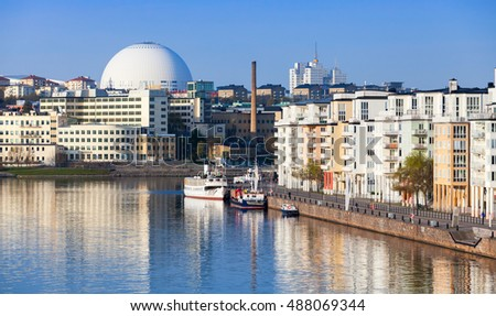 Cityscape with modern living houses in Stockholm. Sodermalm district, Masthamnen embankment. Stockholm Globe Arena on a background