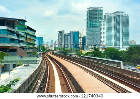 Cityscape with railway and high office buildings in Kuala Lumpur, Malaysia