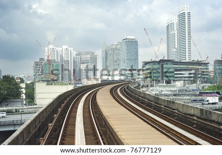 Cityscape with railway and high office buildings in Kuala Lumpur, Malaysia - stock photo