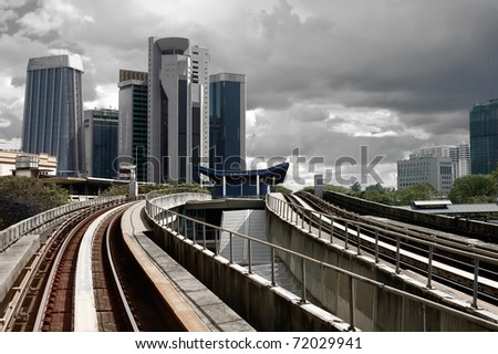 Cityscape with railway and high office buildings in Kuala Lumpur, Malaysia, Asia.