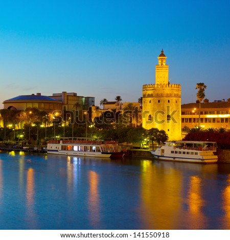 cityscape with river of Seville at night, Spain - stock photo