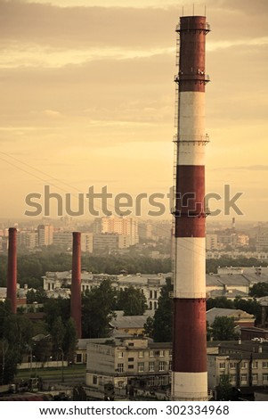 Cityscape with smokestacks at the sepia tone - stock photo