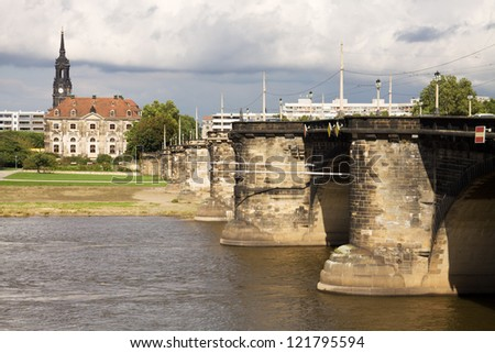 Cityscape with the Augustus Bridge over Elbe river in Dresden, Germany. The Augustus Bridge is the oldest bridge in the city of Dresden. It was built between 1907 and 1910 - stock photo