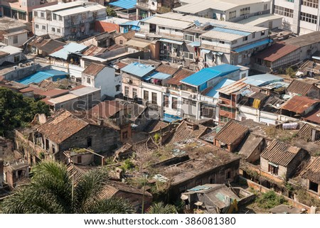 cityscape with urban slums - stock photo