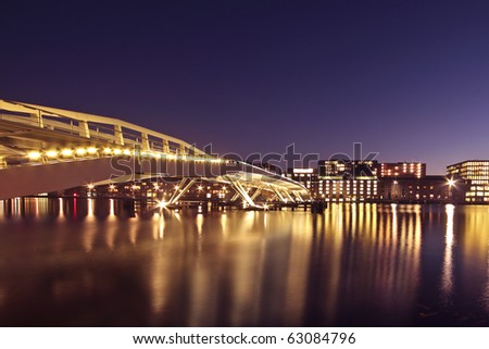 Cityscenic in Amsterdam with the Jan Schaeferbridge in the Netherlands at night