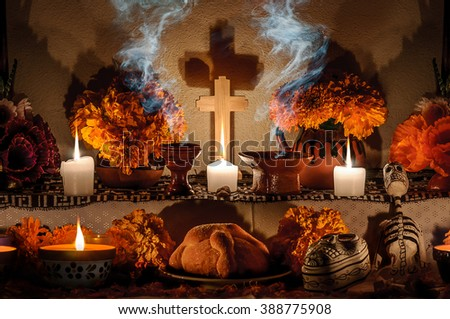 CIUDAD DE MEXICO, CDMX / MEXICO- OCTOBER 31 2015: Traditional day of the dead altar with pan de muerto and candles. Festivity celebrated throughout Mexico in October 31, November 1 and November 2 - stock photo