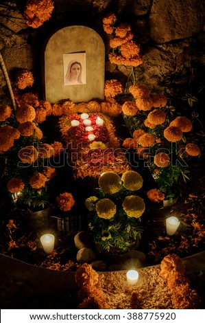 CIUDAD DE MEXICO, CDMX / MEXICO- OCTOBER 31 2015: Traditional day of the dead altar with sugar skulls and candles. Festivity celebrated throughout Mexico in October 31, November 1 and November 2 - stock photo