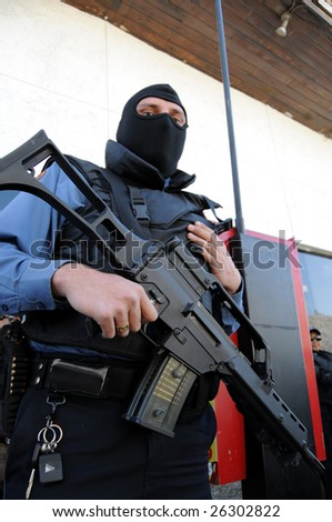 CIUDAD JUAREZ, MEXICO - FEB 27: A masked and armed special forces soldier stands ready to face drug cartels on February 27, 2009, in the violence-ridden border city of Ciudad Juarez, Mexico. - stock photo