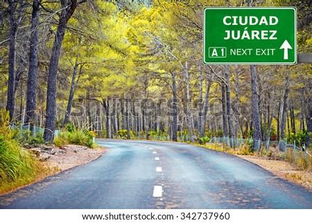 CIUDAD JUAREZ road sign against clear blue sky - stock photo