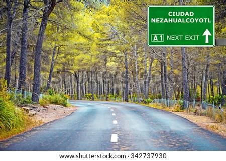 CIUDAD NEZAHUALCOYOTL road sign against clear blue sky - stock photo