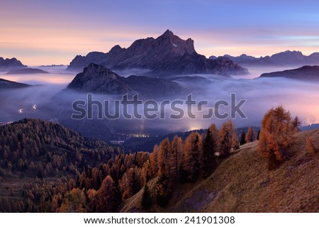 Civetta mountain above night inversion cover, Dolomites, Italy - stock photo