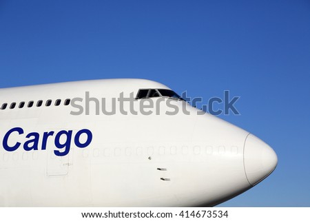 Civil cargo airplane standing on a parking place. - stock photo