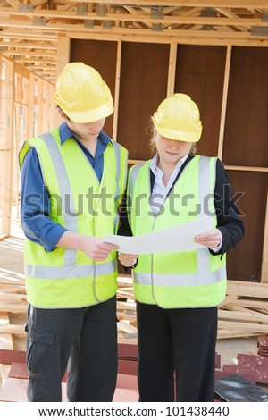 civil engineer and worker discussing issues at the construction site - stock photo