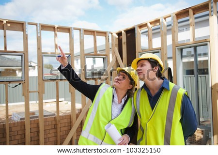 civil engineer and worker discussing issues at the construction site