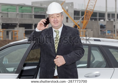 Civil engineer at the construction site - stock photo