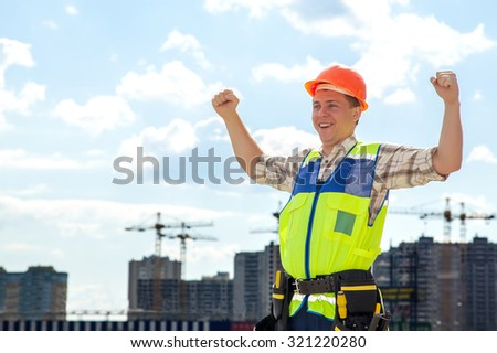Civil engineer wearing a safety vest with a plan on construction site. Belt with the tools on his belt He smiles and is happy. When the work is done perfectly. - stock photo