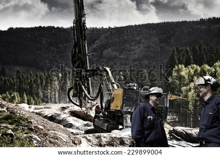 civil engineering, rock drilling and dynamite industry preparing for roads - stock photo