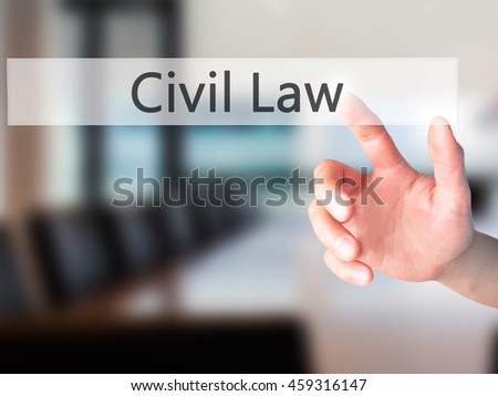 Civil Law - Hand pressing a button on blurred background concept . Business, technology, internet concept. Stock Photo