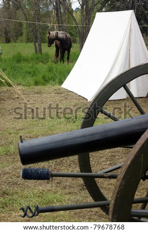 Civil War Camp Cannon Tent Horse Mount Vertical Composition - stock photo