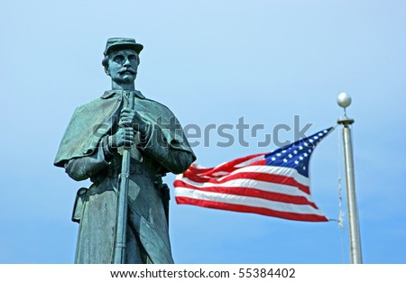 Civil war statue with American flag - stock photo