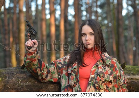Civilian girl is practicing with her gun - stock photo