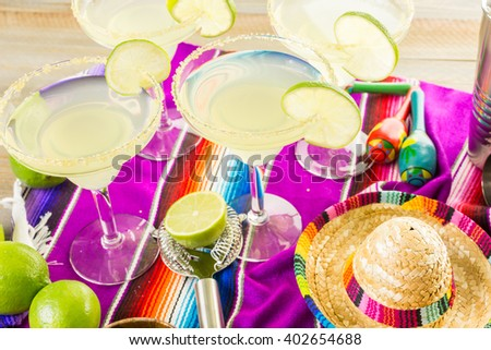 Claasic lime margarita with garnish lime and turbinado sugar for Fiesta.