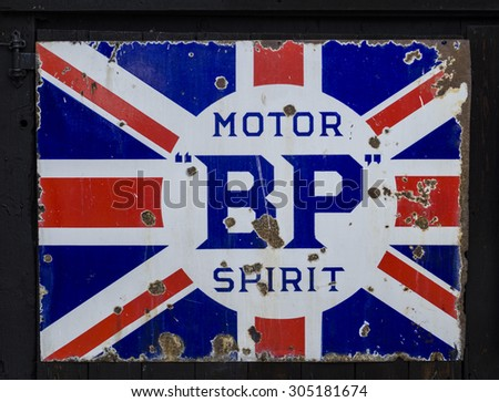 Clacton-on-sea,Essex, England, UK: 15 April 2014- A very old BP  logo in the shape of the union jack flag, on the side of a building.