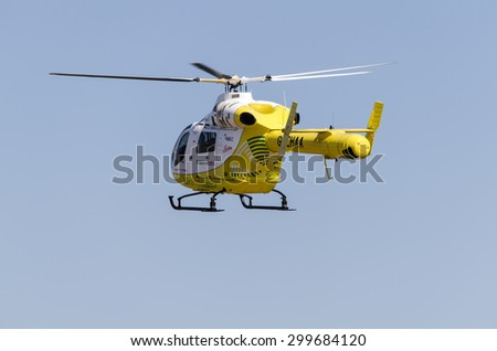 Clacton-on-sea, Essex, England, UK: 1 August 2013- Helicopter rescue, Yellow helicopter in the air while flying on blue sky, on its way to rescue someone.  - stock photo