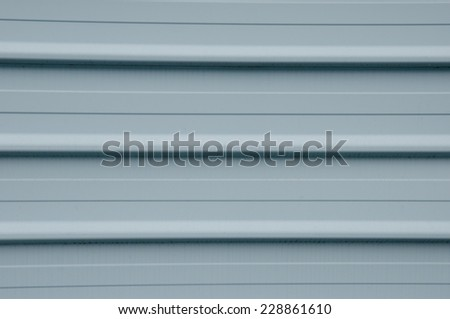 cladding, wall made of grey metal planks, close up - stock photo