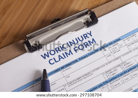 Claim form for a work injury on a desk top - stock photo